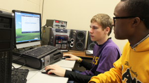 Junior Tanner Anderson works with the radio station equipment. Anderson programs 93.5 FM with school news and announcements.