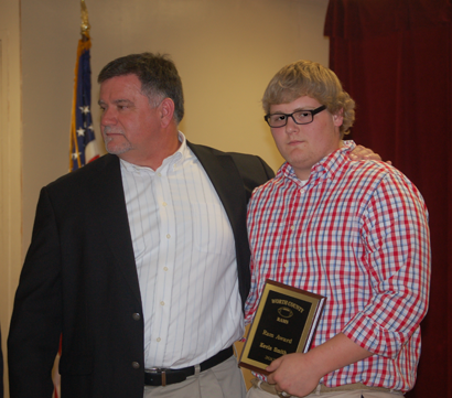 Coach Scotty Ward presents senior offensive lineman Kevin Smith with the coveted Ram Award.