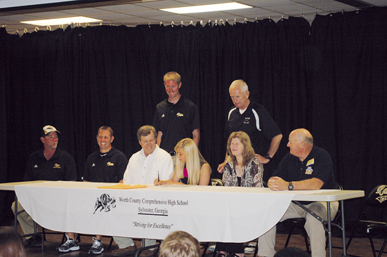 WCHS senior Brittany Pittman signs a soccer scholarship with Andrew College last Thursday morning. In addition to her parents James and Peggy, the Worth senior was joined on stage by coaches Terry Sinclair, Mitch Mitchell, Head Coach Colby Simpson, Athletic Director Russ Beard, and Andrew College Head Coach Blane.