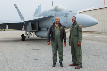 Commander Claven Williams (U.S. Navy, ret.) and his son Lt. Commander Chris Williams stand before Chris's Navy F-18 during the annual Aviation Awareness Day on Friday, March 22.