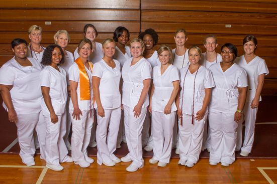 The nursing graduates from the Albany area pose before the nurse pinning ceremony. Front row from left to right: Krishondria Thomas, Theresa Uzodinma, Tina Giovingo, Carrie Pittman, Stacie Rolland, Kemberly Miller, Randee Roberts, and Latifah Powell. Back row from left to right: Mary Hart, Janet Grinder, Robin Hussion-Dale, Ebonee Purnell, RachelOluwo, Nicole Patteson, Susan Flowers, and Young Bozeman.
