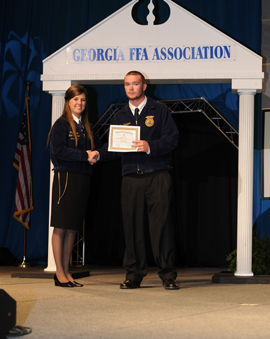 Nine WCHS FFA members and three WCMS FFA members recently attended the 2013 Georgia FFA Convention. Senior Ben Culpepper earned and received his State FFA Degree which was presented to him by State FFA President Dolly Melton (Echols County FFA).