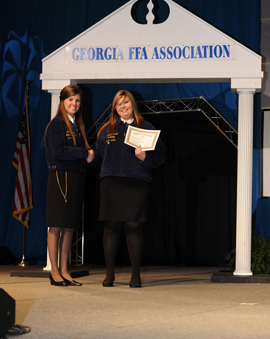 Senior Kelsey Powell earned and received her State FFA Degree at the 2013 Georgia FFA Convention. It was presented to her by State FFA President Dolly Melton (Echols County FFA).