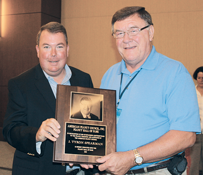 Joe West of McCleskey Mills and chair elect of the American Peanut Council, presents Tyron Spearman with the Peanut Hall of Fame Award at the recent USA Peanut Congress.