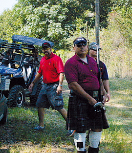 Scottish clad Shelley Miller displays his skills on the true pair (rabbitt) course at Green Lakes Hunting Club in Ocilla. His attire is to honor his membership as a member of the Valdosta Fire Department pipe and drum corps.