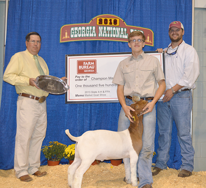 Georgia Farm Bureau Young Farmer Coordinator Jed Evans, right, presents the prize check to Roberts as Chad Coburn, left, who judged the show, presents Roberts a silver platter.