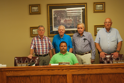 """Poulan's Mayor Dustin Grubbs, seated, is shown signing a proclamation declaring Oct. 10 as """"Lions Club Day in Poulan."""" Standing left to right are charter members: John F. Porter, Earl Fletcher, James Elbert Kilcrease and Lyndel E. Ford."""