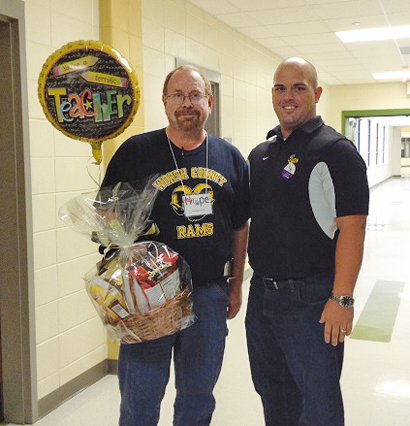 WCES Principal Steven Rouse congratulates Michael Fulp, Teacher of the Year.
