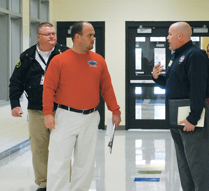 Worth County EMA Director Tom Whittington and WCES Principal Steven Rouse joined GEMA School Safety Coordinator Frank Maneer during a tour of WCES. Maneer was asked to evaluate Worth County schools in an effort to increase safety.