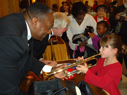 Musicians assist patrons with instruments at the 2103 Instrument Petting Zoo.