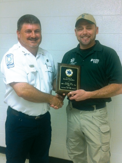 Robby Royal, Turner County EMS Director, presents 2014 Southwest Georgia's EMS of the Year award to Phoebe Worth EMS Director Kevin Lassiter at the Region VIII banquet in Moultrie.