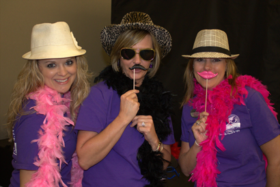 Pictured, from left, in their celebratory costumes courtesy of the FrameWorks 123 FotoBooth, are MTC Career Services Specialist Bridgett Adams, Neuromuscular Massage Therapist program instructor Michaela Underwood, and MTC Registrar Wendi Tostenson.