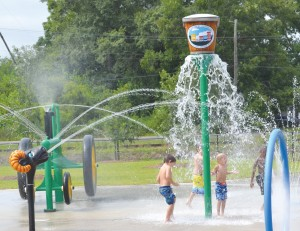 The new splash park opened at 10:00 a.m. on Saturday, August 1 and local kids immediately gathered to get some splashing in before the start of school on Monday.