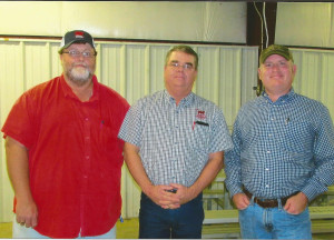 Pictured L to R: Kevin Kimbrel of Golden Farm & Garden, WCLA President David Carter, and Beau Hatcher of Flint River Mills.